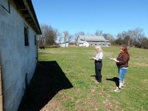 Graduate Students Kate Sproul and Sherry Teal at the Moore Farm
