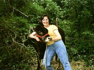 Elsie Prater and calf at Prater Farm in Knox County