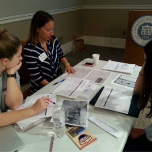 Teachers analyzing primary sources at a TPS-MTSU workshop.